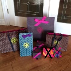 Tory burch boxes and shopping TORY BURCH DUST BAGS AND JEWELRY POUCHES ALSO AVAILABLE!! Authentic!! Let me know which ones you're interested in so I can make a new listing for you. If you purchase this listing it will include all items shown. They have never been used! Boxes come with bow ribbons and tissues inside. CHECK OUT MT CLOSET FOR MORE tb dust bags and also other brand boxes, and dust bags ! Sold pink/orange for $12 , purple/blue for $10 for reference . The two shown with X's in the…