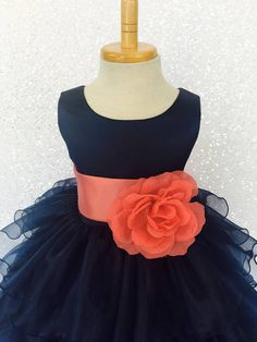 Beautiful organza ruffled dress tailor-made and ready to impress at any upscale event!   Handcrafted with the upmost of care and attention to detail, we make sure that each dress is perfectly one of a kind for your little girl.  Bridal satin top followed by a satin sash for a nice Coral Flower Girl Dresses, Navy Blue Bridesmaid Dresses, Blue Wedding Dresses, Wedding Dresses Plus Size, Wedding Bridesmaids, Coral Dress, Flower Girls, Satin Sash, Satin Top