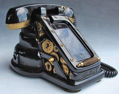 Steampunk iPhone dock.  The voice commands are routed through the handset so you can actually make calls!  From freelandstudios at thestudiodoor.etsy.com $350