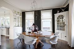 Black walls contrast and highlight white millwork & trim. Love the blown glass vessels (scale & colour) & mobile chandelier.