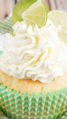 Key Lime Pie Cupcakes ~ light and fluffy, filled with sweet key lime curd and topped with a whipped vanilla lime frosting!