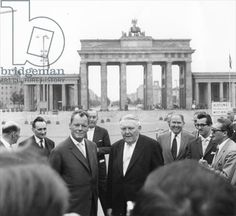 Ludwig Erhard and Willy Brandt, Mayor of West Berlin, inspect the sector border at Brandenburg Gate prior to the completion of the Berlin Wall, 25 August 1961 (b/w photo)