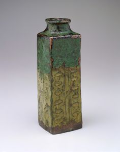 Yatsushiro or Shodai ware vase in the form of an archaic Chinese cong  1700-1800      Edo period     Stoneware with rice-straw ash and copper-green glazes  H: 23.7 W: 8.3 cm   Japan