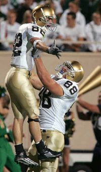 Notre Dame Football Player WR Matt Shelton leaps into the arms of Anthony Fasano after Shelton scored on a 35-yard pass in the second quarter. Photo Credit: AP Photo/Bob Brodbeck
