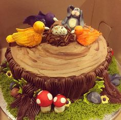 #woodlands theme #babyshower #cake for a boy.. The parents are the larger birds, theyre 2yr old son is the smaller bird, their pet boxer is a bunny, and theyre all waiting for the egg to hatch!!#fondant #mushrooms #grass #treestump #buttercups #rocks #leaves #birds #nest #egg #bunny