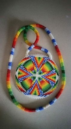 Native Beaded medallion by Lennis Native Beading Patterns, Beadwork Designs, Seed Bead Patterns, Loom Patterns, Stitch Patterns, Native American Regalia, Native American Beadwork, Native American Jewelry, American Clothing