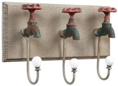 upcycled faucets become coat hooks
