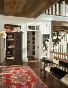 Luminous three-story, shingle-style cottage on Whitefish Lake