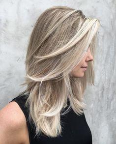 Platinum blonde highlights by Riawna Capri
