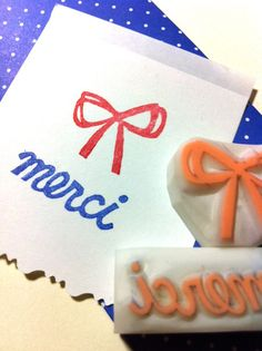 ribbon & merci hand carved rubber stamp. handmade rubber stamp. set of 2.. $9.00, via Etsy.