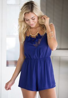This royal blue romper flawlessly fuses chic and classically femme details.