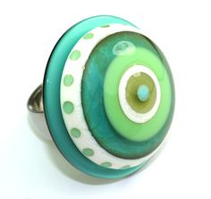 Glass circles mounted on rings by Anlukaa