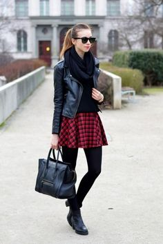 Shop this look on Lookastic:  https://lookastic.com/women/looks/biker-jacket-crew-neck-sweater-skater-skirt-ankle-boots-tote-bag-scarf-watch-tights/6383  — Black Scarf  — Black Leather Biker Jacket  — Gold Watch  — Black Crew-neck Sweater  — Red Plaid Skater Skirt  — Black Wool Tights  — Black Leather Tote Bag  — Black Leather Ankle Boots