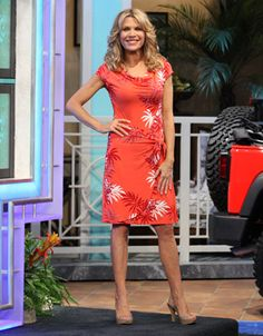 TOMMY BAHAMA: Palms Ashade dress in orange w/abstract red and white palm fronds, cowl neckline, cap sleeves, wrap skirt w/tie at left hip | Vanna White's dresses | Wheel of Fortune