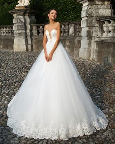 Sexy #Wedding Dress 2017! Lace, Organza, Tulle, and Satin A-Line Gown with an Illusion Lace Deep Sweetheart Neckline, Illusion Tank Straps, Beaded Lace Fitted and Boned Bodice to Natural Waistline, Gathered Tulle Layered A-Line Skirt with a Beaded Lace Hemline, Chapel Train, Lace Mid Back with Corset Closure. #corsetweddingdresses #sexyweddingdresses #2017weddingdresses #bridalgowns #dreamweddingdresses #weddinggowns #sayyestothedress