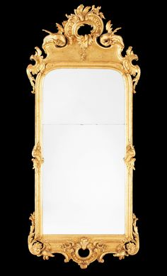 A Swedish Rococo mid 18th century mirror in the manner of C. Hårleman.