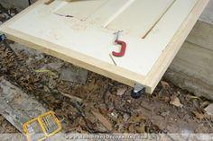 DIY rolling barn doors - add casters to bottom of doors