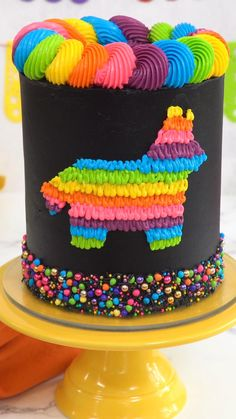 This Piñata Cake is the ultimate party cake! Picture layers of moist, deep dark chocolate cake, stacked with rich chocolate buttercream, and filled to the brim with colorful chocolate candy that POURS out when you cut into it! And the best part? It's easier to make than you'd think!
