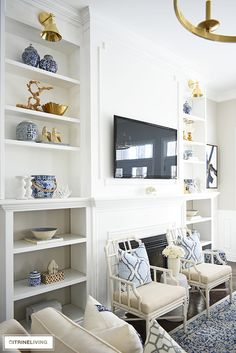 Styling shelves can be tricky! I'm sharing how to decorate bookshelves with simple ideas that you can use to create a gorgeous spring-styled space! Bookshelf Inspiration, Decorating Bookshelves, Coastal Living Rooms, White Sofas, Room Shelves, Coffee Table Design, Diy Home Decor, Home Goods, New Homes