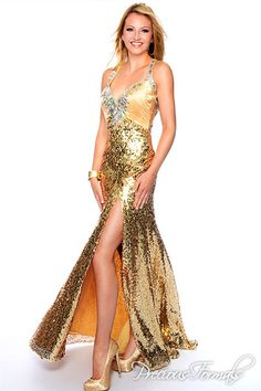 c6f06f28f4c88 Precious Formals Style Sheer sequin-covered panels form a partial back to  this shimmery slitted gown.