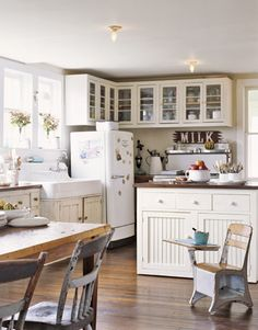 New overhead cupboards were fashioned to mimic original cupboards near the sink. A vintage-style island was custom built with wheels so it can be rolled out of the way or to a new location.