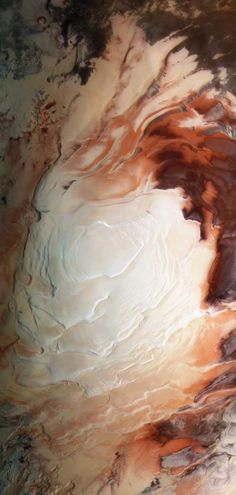 The south pole of Mars, like the cream on a latte. Photo by ESA / G. Neukum (Freie Universitaet, Berlin) / Bill Dunford
