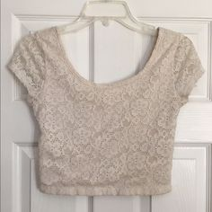 Mossimo Cream Lace Crop Top Really pretty lace crop top. Worn only 2 or 3 times. Fits nicely and is comfortable, I just don't wear crop tops anymore. Mossimo Supply Co Tops Crop Tops