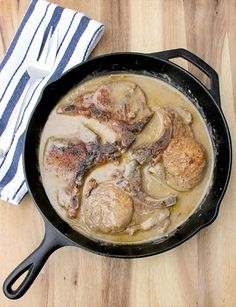 Baked Pork Chops with Cream of Mushroom Soup in a cast-iron skillet.