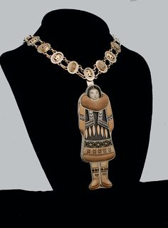 ESKIMO FIGURE Pendant, Denise and Samuel  Wallace, with Dawn Wallace, sterling silver, 14kt gold, fossil walrus ivory. Aleut