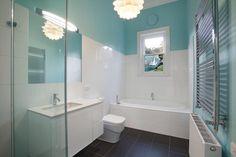 Crisp colours in a simple bathroom. Grey Water Recycling, Simple Bathroom, Bathroom Ideas, Outdoor Living Areas, Sustainable Design, Corner Bathtub, French Doors, Design Elements, Flooring