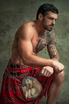 Not fitting our theme, but hot nonetheless.  Some guys look great in kilts!