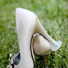 How inventive! We found these 'High Heel Protectors' so you and your #bridal party don't sink into the grass! Photo by Heels Above by RomuloBahiano, via TheFancy.