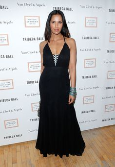 Padma Lakshmi Evening Dress - Padma Lakshmi chose a long black dress, which featured a black-and-white panel in the front, for her look at the Tribeca Ball.