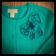 LOFT embellished green cardigan Super cute emerald green cardigan with floral chiffon design on shoulder. No condition issues. 100 % cotton. LOFT Sweaters Cardigans