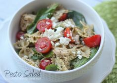 pesto salad with tomatoes, spinach, feta cheese and chicken.