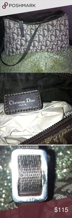 """AUTH CHRISTIAN DIOR MONOGRAM BROWN SHOULDER BAG Authentic Christian Dior handbag brown logo monogram Shoulder bag. Trimmed with Brown leather. Top zippered closure; fuly lined interior , Dior logo, and one interior zip close pocket. Cotton Canvas logo Material: Fabric. Retail value of $595.00 Approximate size: 9"""" Width 6"""" Height. MADE IN ITALY. Item has been pre-owned but still in EXCELLENT CONDITION. 1 OWNER used 4x Pet Free Smoke free environment . Christian Dior Bags Shoulder Bags"""