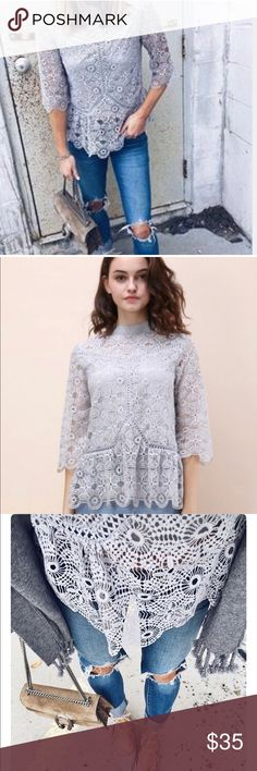 """Chic wish lace peplum top Lovely gray/lilac peplum lace top, as seen on  Cella Jane! It has a shorter lining, scalloped edges and high neck. It's in great condition, there is a loop (2nd) on the neck where there isn't a button, but no sign of a missing button. Cute, cute top! 26"""" long, 18"""" pit to pit, 17"""" waist, 1.5"""" collar, 15"""" sleeve, lining is about 7"""" shy of the bottom of the top. Photo credit: Cellajane.com, chicwish chicwish Tops"""