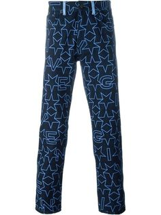 Shop Givenchy star print jeans.