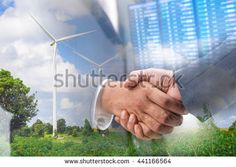 Double exposure of Business handshake ,Investment concept, Eco power, wind turbines Background - stock photo