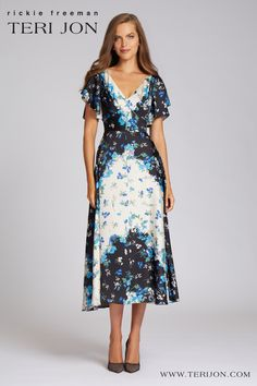 This floral printed cocktail dress is a closet staple! Featuring a tea length cut and short sleeves, this dress exudes elegance. The color scheme and lightweight fabric makes this dress perfect for the fall and spring months. Wear to weddings, engagement parties, formal events. Gowns With Sleeves, Short Sleeves, Short Sleeve Dresses, Collar Dress, V Neck Dress, Spring Months, Backyard Weddings, Engagement Parties, Printed Gowns