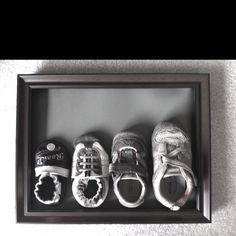 Shadow box with my son's first year of shoes. I took the right shoes and gave the left to my mom for a birthday gift. I got this idea on Pinterest and I couldn't be happier with this!