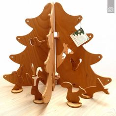 """Wooden Christmas tree """"Forest Walk"""" S - a sustainable modular freestanding decoration with ten animal motifs is made from 5 wings of hand sanded beech plywood and is painted with natural oils and a dash of essential oil. Decorative wooden object and a didactic toy in one - vertical puzzle game."""