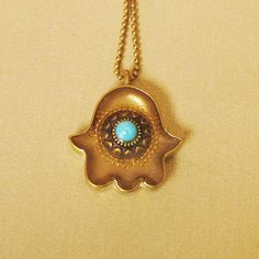 Gold hamsa amulet with turquoise stone by sassonorly on Etsy, $90.00