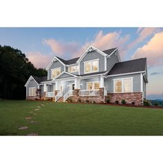 Lowe's Georgia-Pacific Vinyl Siding Cedar Spectrum - Wedgwood - used for emphasis above entry and upper outer windows