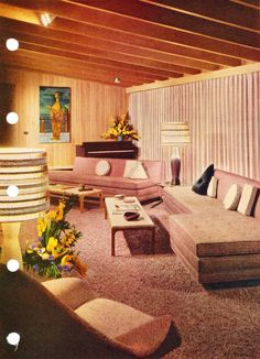 A wood-paneled living room from the Better Homes & Gardens Decoration Book, 1956.
