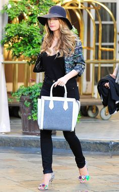Point Blake from Celebrity Street Style  As always, Blake Lively crushes the street style game with a floppy Rag & Bone hat paired with a Glen jacket, Sophia Webster heels and a drool-worthy Henri Bendel Rivington tote.