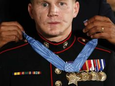 U.S. President Barack Obama presents the Medal of Honor to retired U.S. Marine Corps Corporal William 'Kyle' Carpenter during a ceremony at ...(Reuters) Jun 19, 2014