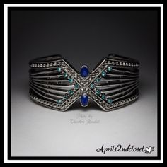 """Blue Stone Statement Cuff Bracelet Glam Deco  NEW WITH TAGS    Blue Stone Geometric Statement Cuff Bracelet Glam Deco  * Beautiful Deep Blue & Aqua stones  * Bold cutout accents   * Well made & high quality construction   * Measures 1.5"""" cuff opening, 1"""" width  Material: Rhodium Plated Base Metal, Glass, & Acrylic  Color: Blue & Silver Combo Item:   No Trades ✅ Offers Considered*/Bundle Discounts✅  *Please use the 'offer' button above to submit an offer. BCBG Jewelry Bracelets"""