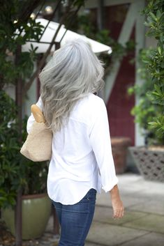 Shades of gray hair can look modern and youthful. Meet Hilary, whose sexy silver mane is redefining how we look at dyeing our hair. Shades Of Grey, Fifty Shades, Natural White Hair, Grey Hair Inspiration, Salt And Pepper Hair, Long Gray Hair, Transitioning Hairstyles, Going Gray, Light Hair