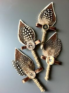 feather and button boutonnieres http://loveisbrewing.blogspot.com/2012/01/diy-boutonnieres.html